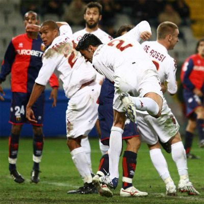 Panucci scores while De Rossi blocks Borriello