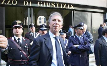 Enrico Preziosi in front of the Palace of Justice (??)