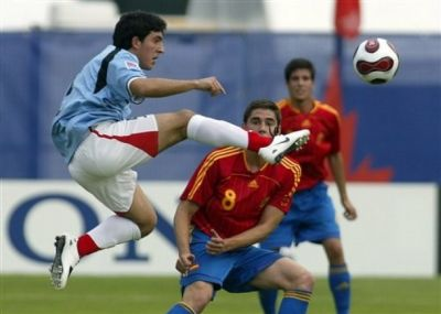 Midfielder Marcel Roman in the blue shirt of Uruguay against Spain