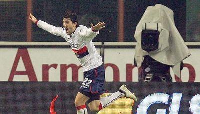 Diego Milito celebrates his goal against Milan: 1-1