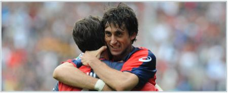 Diego Milito celebrates one of his many goals with Giuseppe Sculli