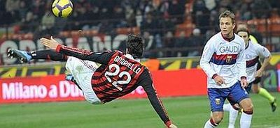Marco Borriello (in off-side position) scores against his former team Genoa