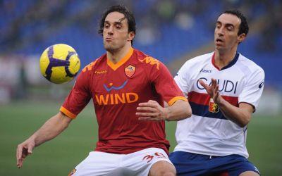 Dario Dainelli controls Luca Toni
