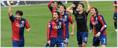 The players of Genoa celebrate the victory against Cagliari