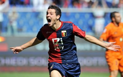 Mattia Destro celebrates his first goal in his first match with Genoa