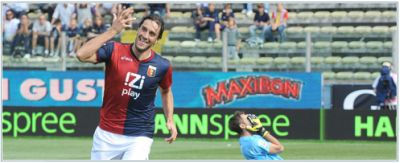 Luca Toni celebrates his first goal with Genoa