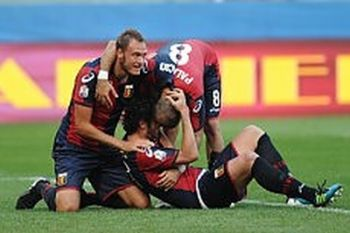 Kakhaber Kaladze has scored the winning goal and is thanked by Granqvist and Palacio