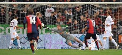 Bosko Jankovic scores the opening goal against Maarten Stekelenburg of A.S. Roma
