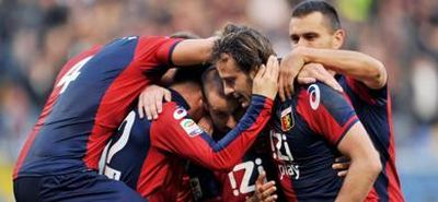 The players of Genoa celebrate the 3rd goal against Udinese