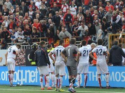 The players of Genoa in discussion with the fans after the match in Novara