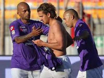 Goalscorer Cerci is thanked by ex-Genoani Olivera and Kharja