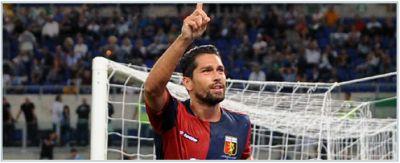 Marco Borriello celebrates his goal against Lazio