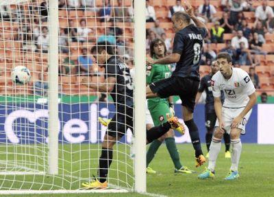 Inter Milan's Nagatomo heads the ball to score against Genoa during their Italian Serie A soccer match at the San Siro stadium in Milan