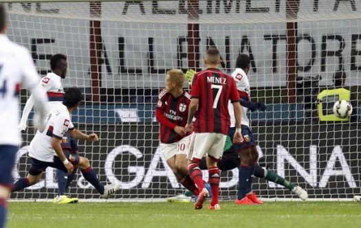 Genoa's Costa shoots as his team mate Niang touches the ball to score a second goal againt AC Milan  during their Italian Serie A soccer match in Milan